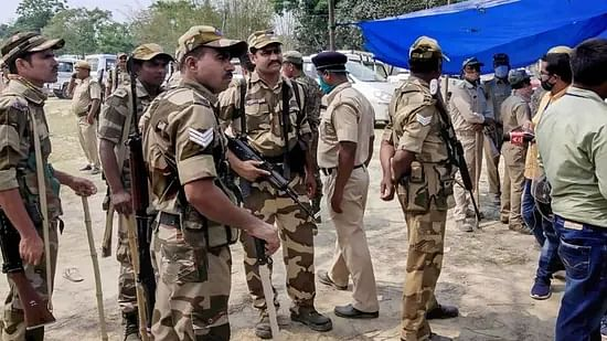 Security personnel keep vigil at a polling station in Sitalkuchi.