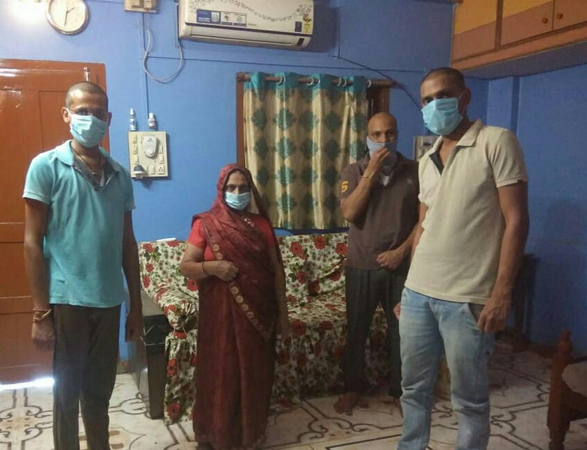 Manorama Gupta with her sons at their house in Gandhwani