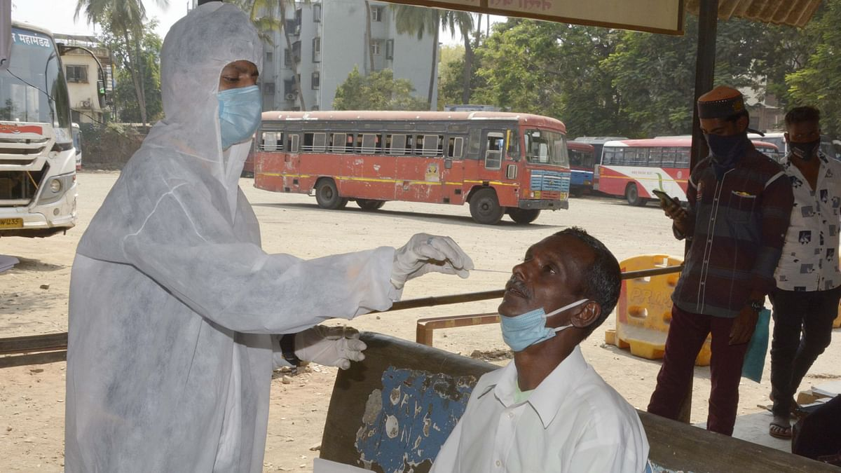 Passengers at Nensi ST bus Depo Borivali, Mumbai take swab test before travel