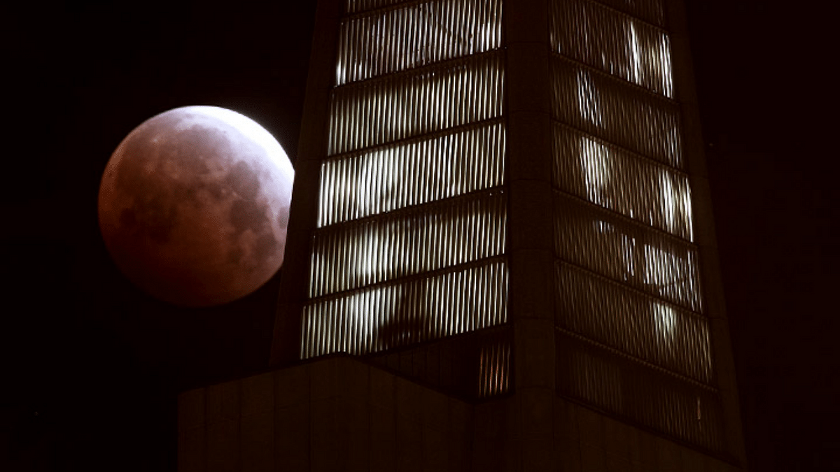 Super Blood Moon behind the Transamerica Pyramid in San Francisco on May 26, 2021.