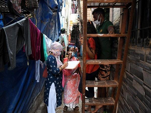A healthcare worker conducting a door to door survey.