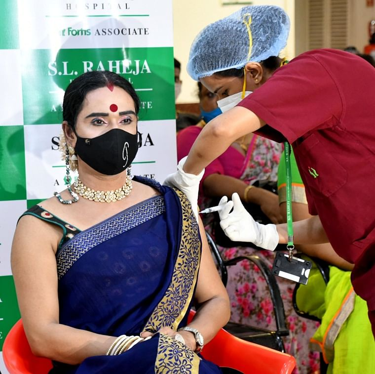 A medic inoculates the dose of the COVID19 vaccine to transgender at Raheja Hospital in Mumbai on Thursday