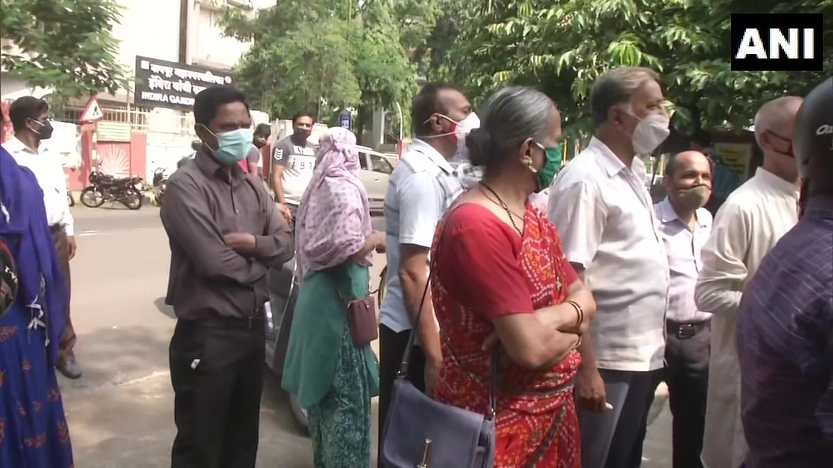 People gather outisde a Covid-19 vaccination centre in Nagpur that was closed due to the vaccine shortage on Wednesday, June 30, 2021.