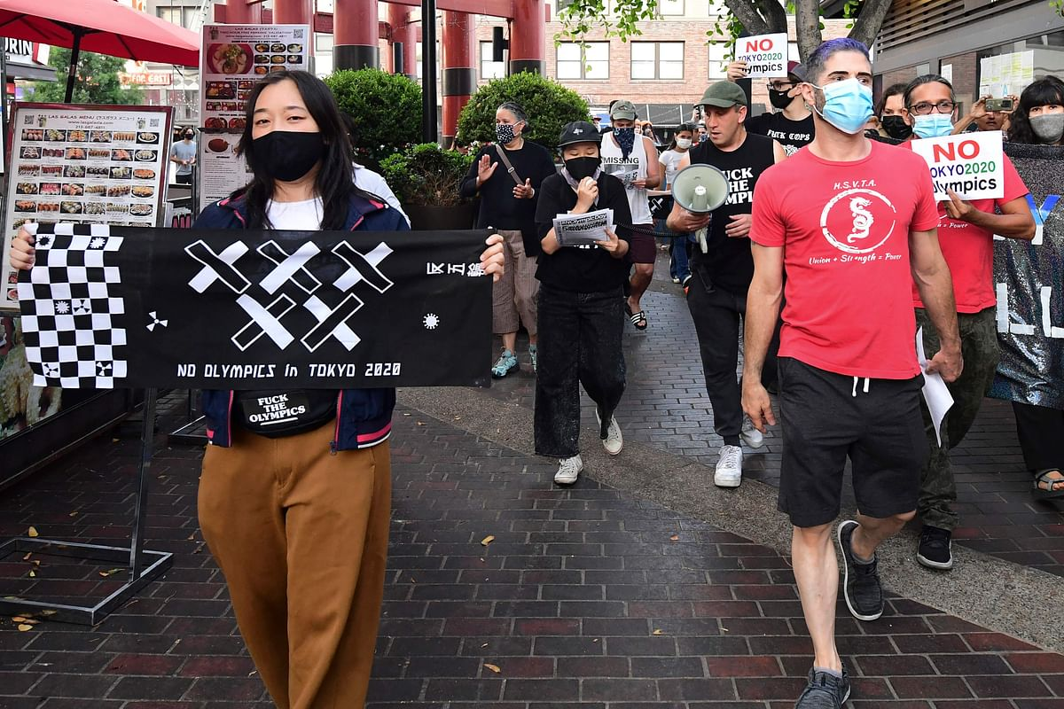Members of NOlympics LA and their supporters gather in Little Tokyo in Los Angeles, California on June 22, 2021 calling for the cancellation of the Tokyo 2020 Olympics.