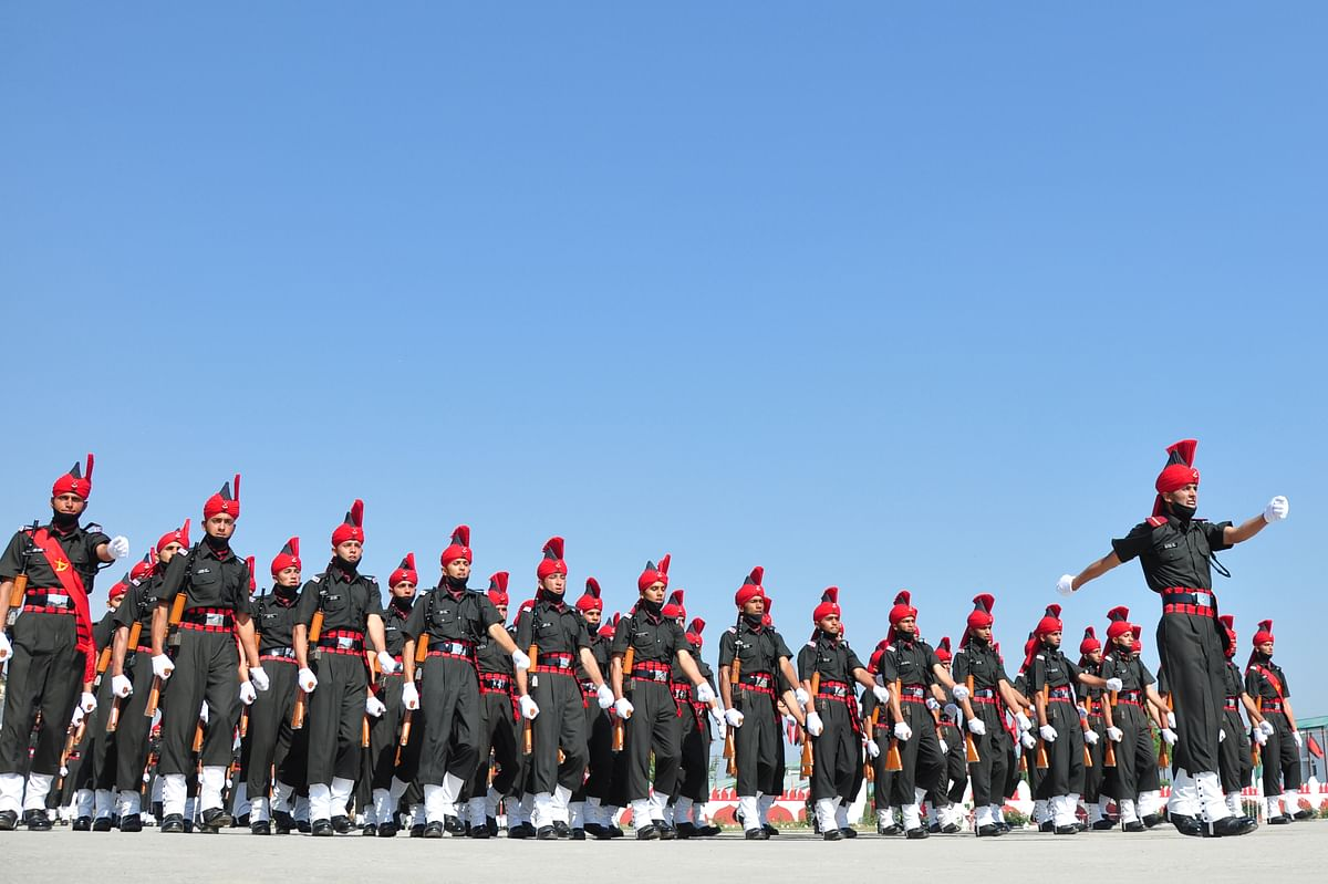 New recruits of the Jammu and Kashmir Light Infantry Regiment (JKLIR) conduct the passing out parade at the army base on the outskirts of Srinagar, on Friday, 25 June 2021.
