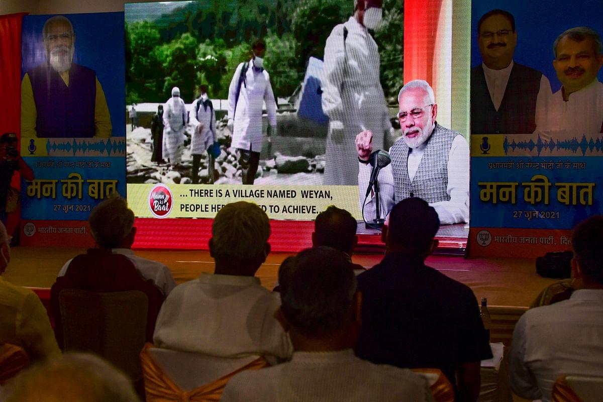 BJP workers listen to PM Modis Mann ki Baat in New Delhi, Sunday, June 27, 2021.