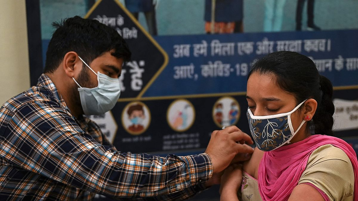 A health worker inoculates a youth with a dose of the Covishield vaccine against the Covid-19 coronavirus during a vaccination drive at a civil hospital in Jind, in the northern state of Haryana on June 1, 2021. (Representative Photo)