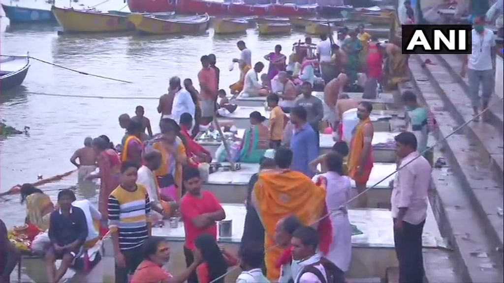 Devotees offer prayers at Ganga Ghat on the occasion of the Ganga Dussehra festival in the ongoing Covid-induced lockdown, in Varanasi, Sunday, June 20, 2021.