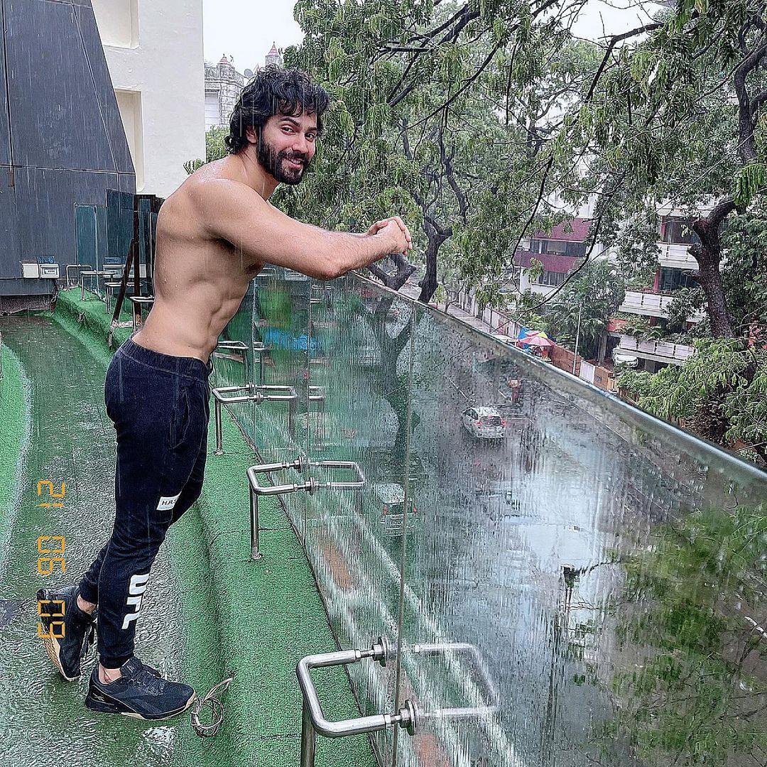 Varun Dhawan shares shirtless pic as he enjoys Mumbai rains; fans say 'baarish me aag laga di'