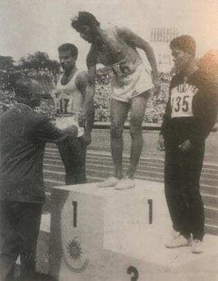 Milkha Singh recieves the gold medal after beating Pakistan's Abdul Khaliq (in white and on left) in the 200m final in 1958 Tokyo Asian Games. Two years later, Milkha again defeated Khaliq in Lahore.