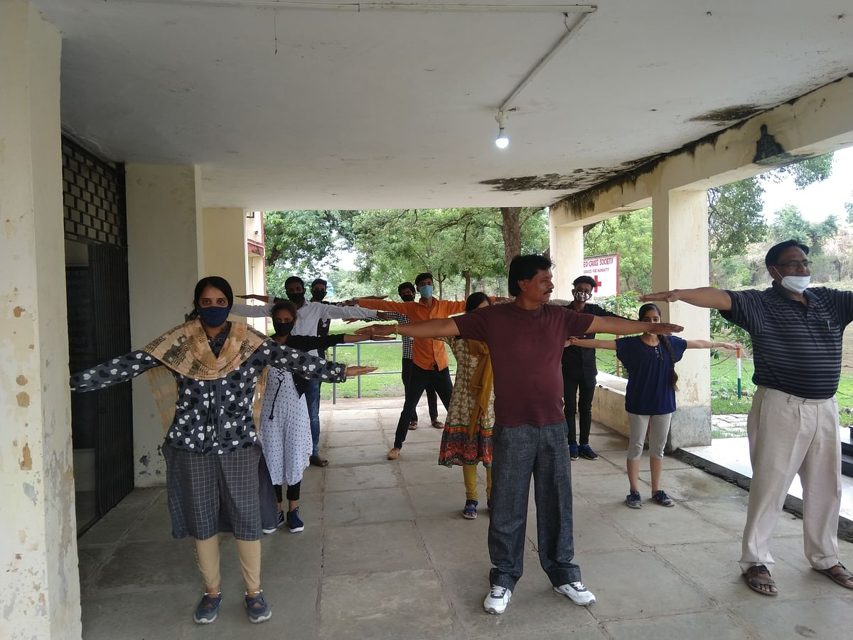 On the occasion of International Yoga Day students practiced yoga at Government College following social distance on Monday