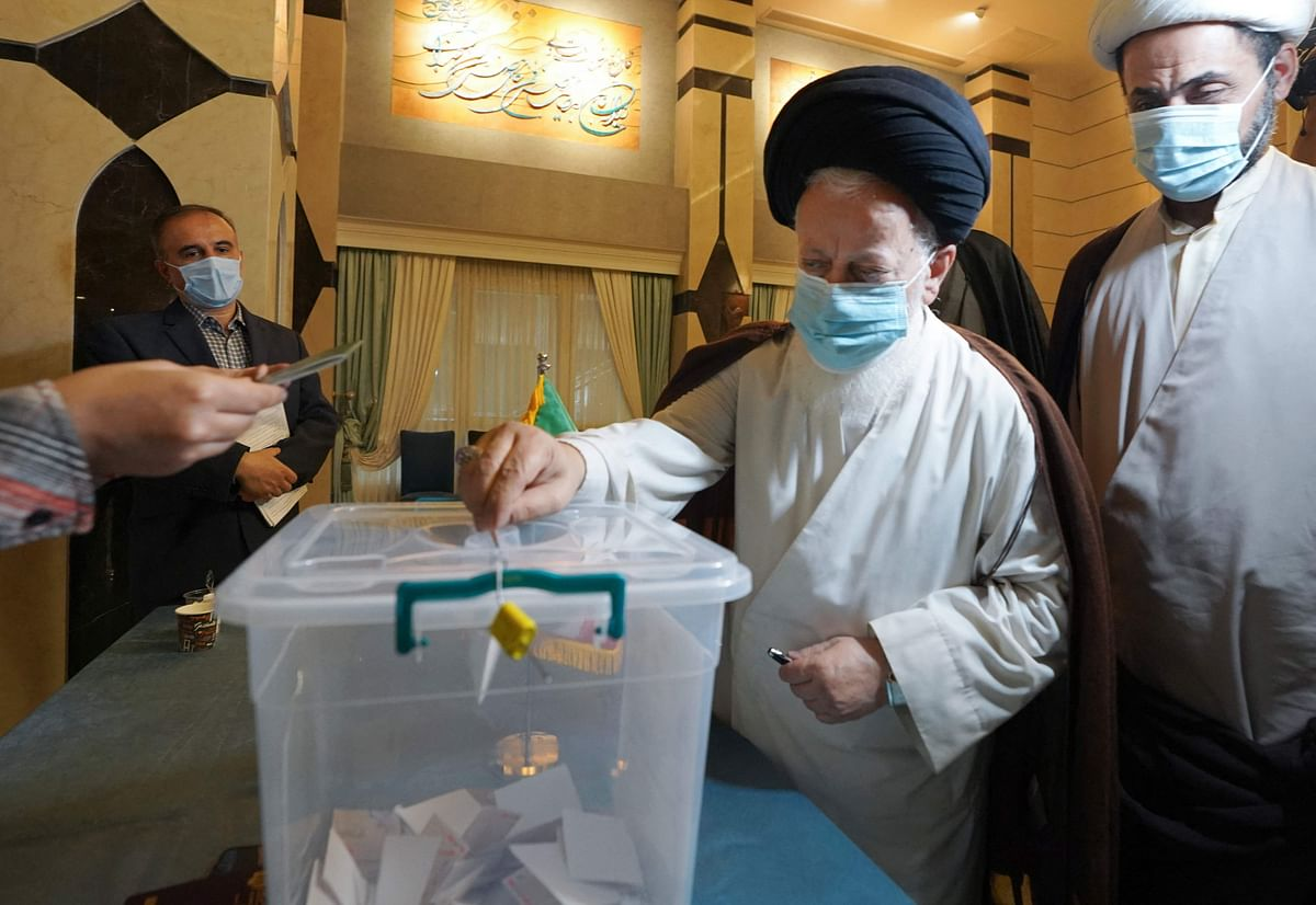 Iranian Shiite clerics based in Iraq vote in Irans presidential election at a polling station in the Iraqi Shiite holy city of Najaf, on June 18, 2021.