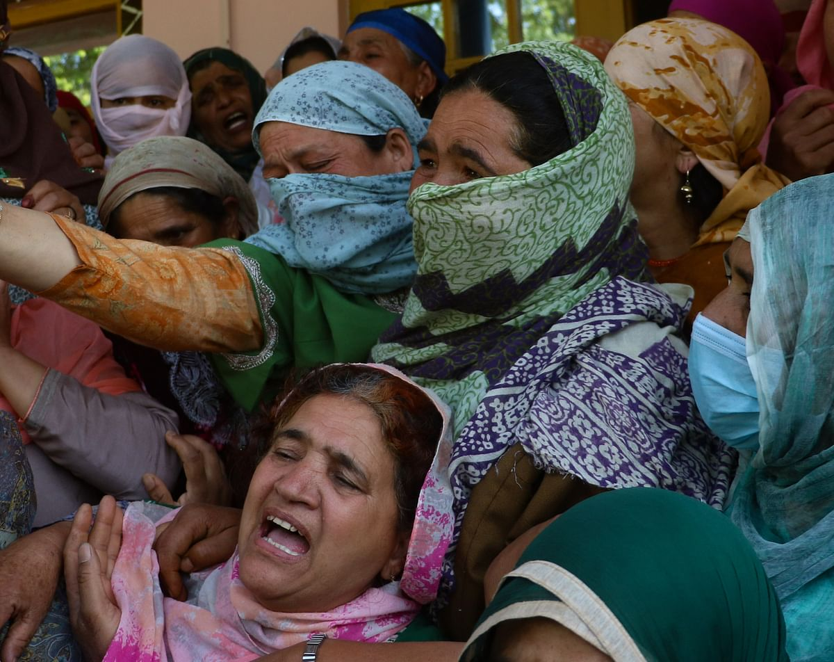 Relatives mourn the death of the daughter of Fayaz Ahmed, former SPO of Jammu & Kashmir Police. Ahmed, his wife, and daughter, were killed by suspected militants in Hariparigam village of Pulwama district in Kashmir on June 27, 2021.