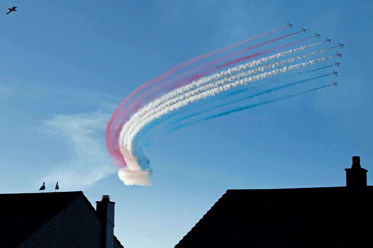 The Royal Air Force Aerobatic Team, the Red Arrows perform a fly-past during the G7 summit in Carbis Bay, Cornwall on June 12, 2021.