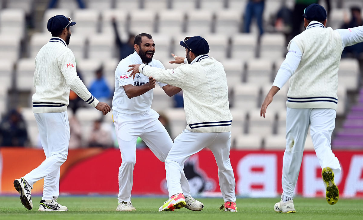 India's Mohammed Shami celebrates the wicket of New Zealand's Kyle Jamieson during the fifth day of the World Test Championship final match between New Zealand and India, at the Rose Bowl in Southampton on Tuesday