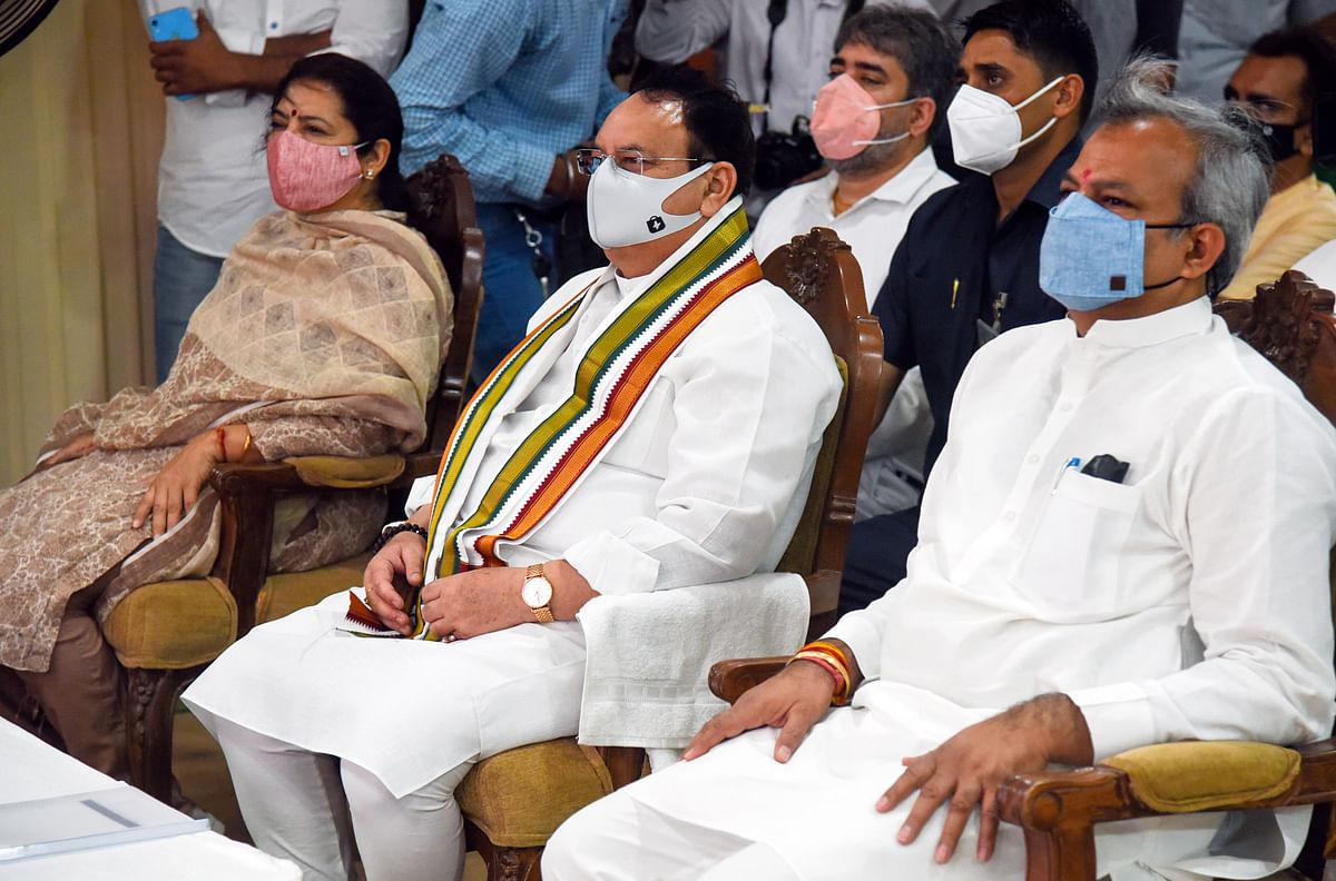 JP National President JP Nadda, party President Adesh Gupta and party leader Meenakshi Lekhi listen to Prime Minister Narendra Modis Mann ki Baat, in New Delhi on Sunday.