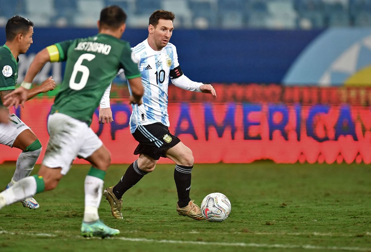 Argentina's Lionel Messi (R) and Bolivia's Leonel Justiniano vie for the ball during the Conmebol Copa America at the Arena Pantanal Stadium in Cuiaba, Brazil, on Monday