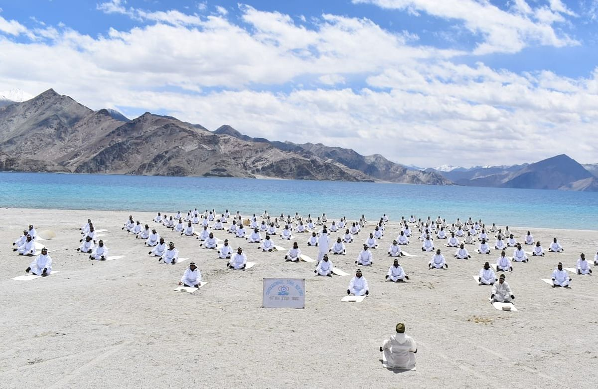 Police (ITBP) performs Yoga alongside Pangong Tso lake in Ladakh, on the occasion of International Yoga Day.