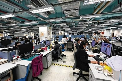 This photo taken on May 11, 2021, shows journalists working in the newsroom of the Apple Daily newspaper in Hong Kong.