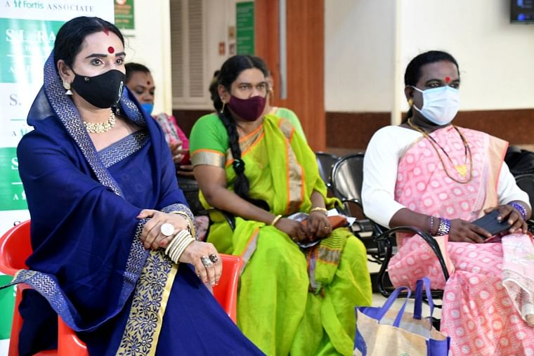Members of the transgender community wait to get themselves inoculated