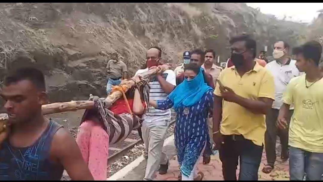 The injured woman being taken hospital