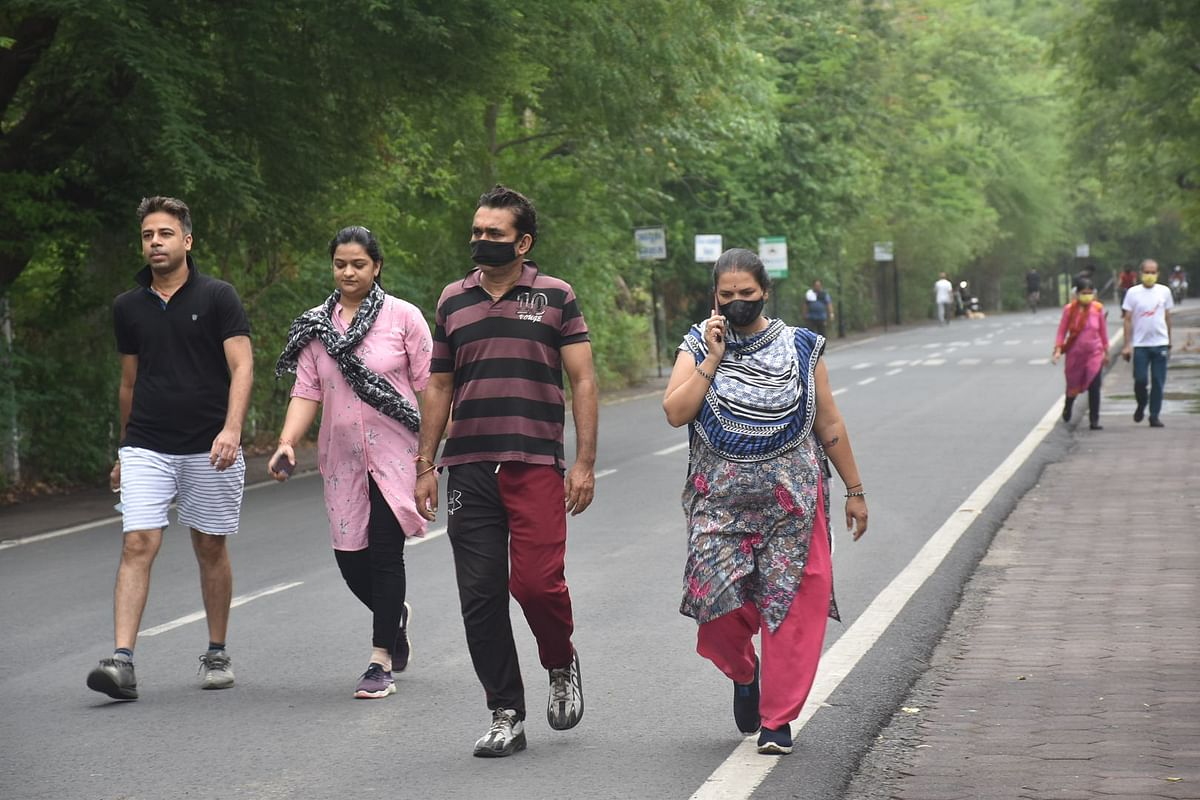 Morning walkers including couples though some of them without face masks moving on Kothi Road during morning walk in Ujjain on Tuesday.