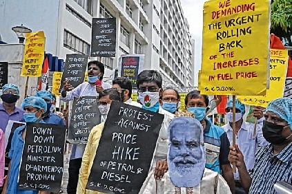 Congress workers carry an effigy of PM Modi and shout slogans during a protest against the fuel price hike in Kolkata on Friday.
