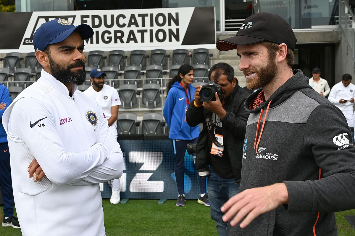 In this file photo taken on March 02, 2020 New Zealand captain Kane Williamson (R) talks to India captain Virat Kohli after New Zealand won the Test series on day three of the second Test cricket match between New Zealand and India at the Hagley Oval in Christchurch. - India and New Zealand face off in the inaugural World Test Championship final at Southampton starting Friday, with a host of modern-day crickets best red-ball players on show.