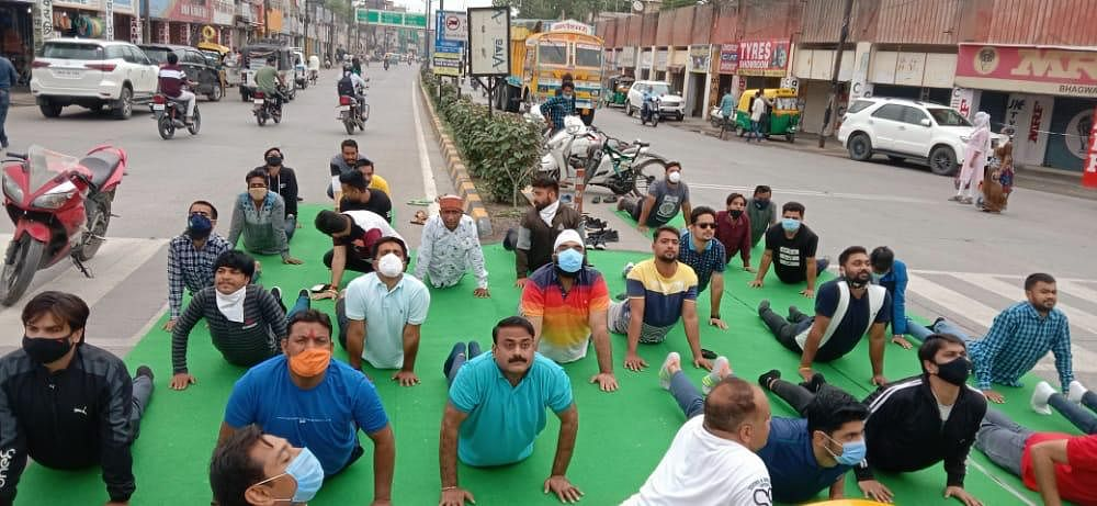 BJYM members performing yoga before the statue of Swami Vivekanand in Indore on Monday