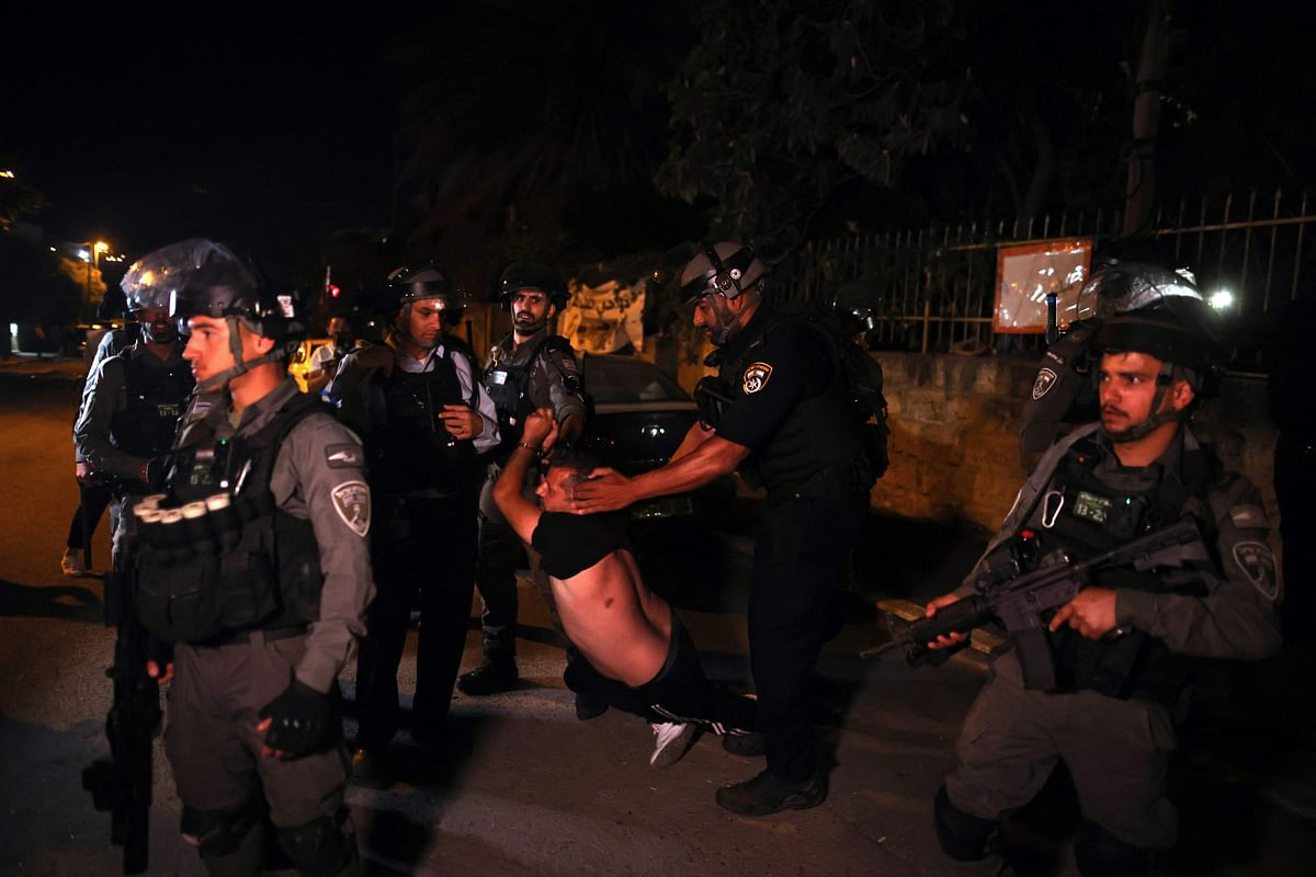 A Palestinian demonstrator is arrested by Israeli security forces, as Palestinian families face eviction, part of an ongoing effort by Jewish Israelis to take control of homes in the Sheikh Jarrah neighbourhood of occupied east Jerusalem, on June 21, 2021.