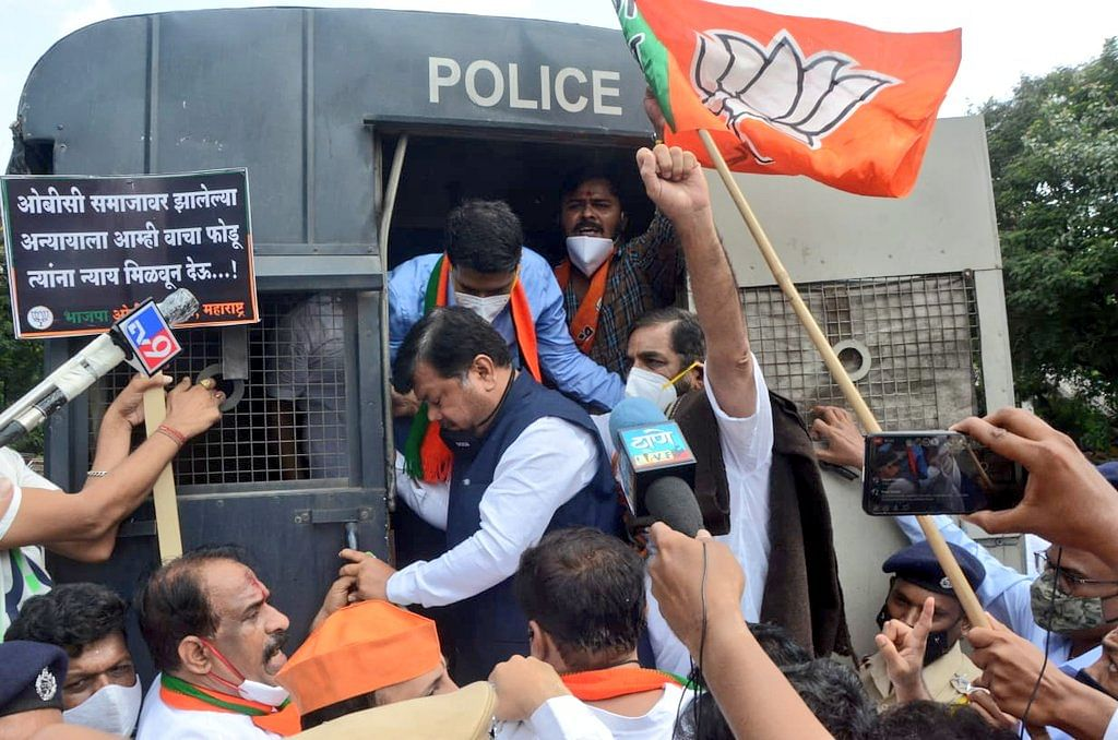 BJP Leader Pravin Darekar with BJP cadre during the protest.
