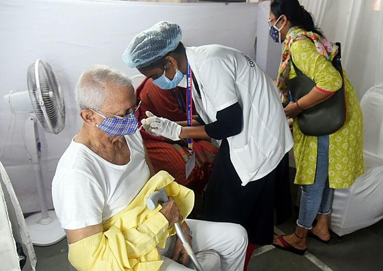 A senior citizen receives COVID-19 vaccine at JB Nagar, in Mumbai on Thursday.