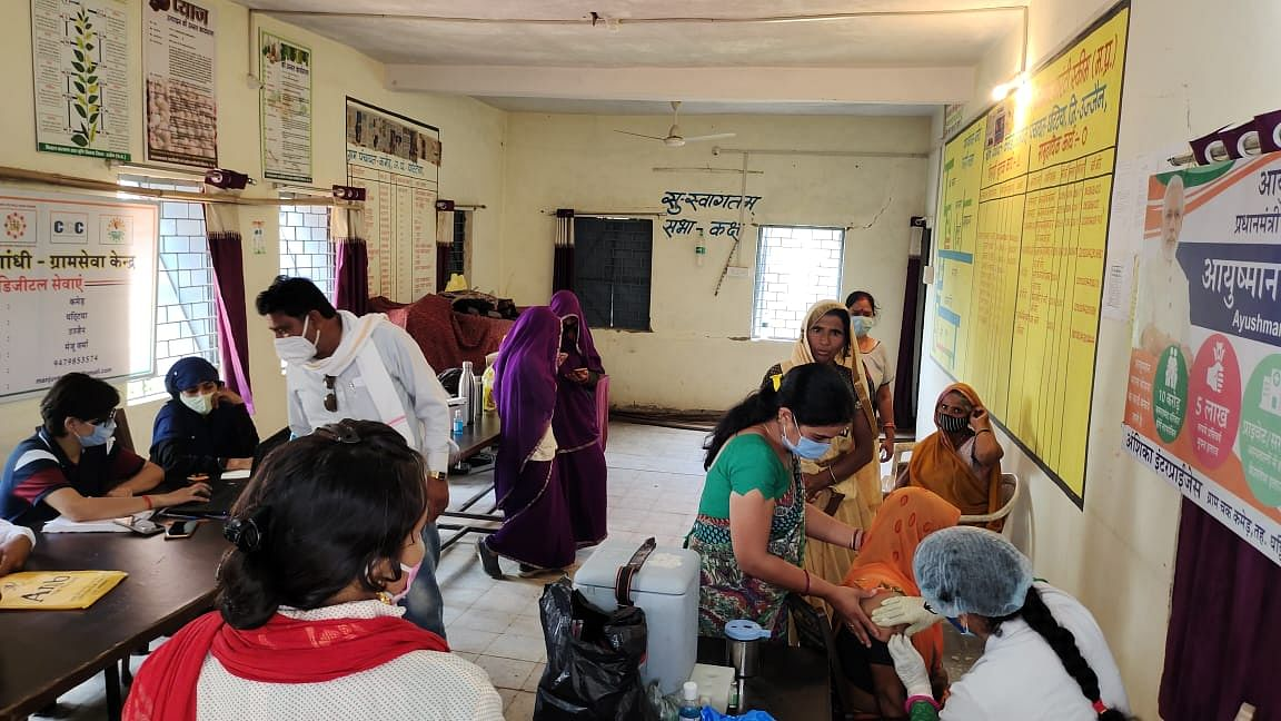 Corona jibes being administered to women at a rural vaccination centre.