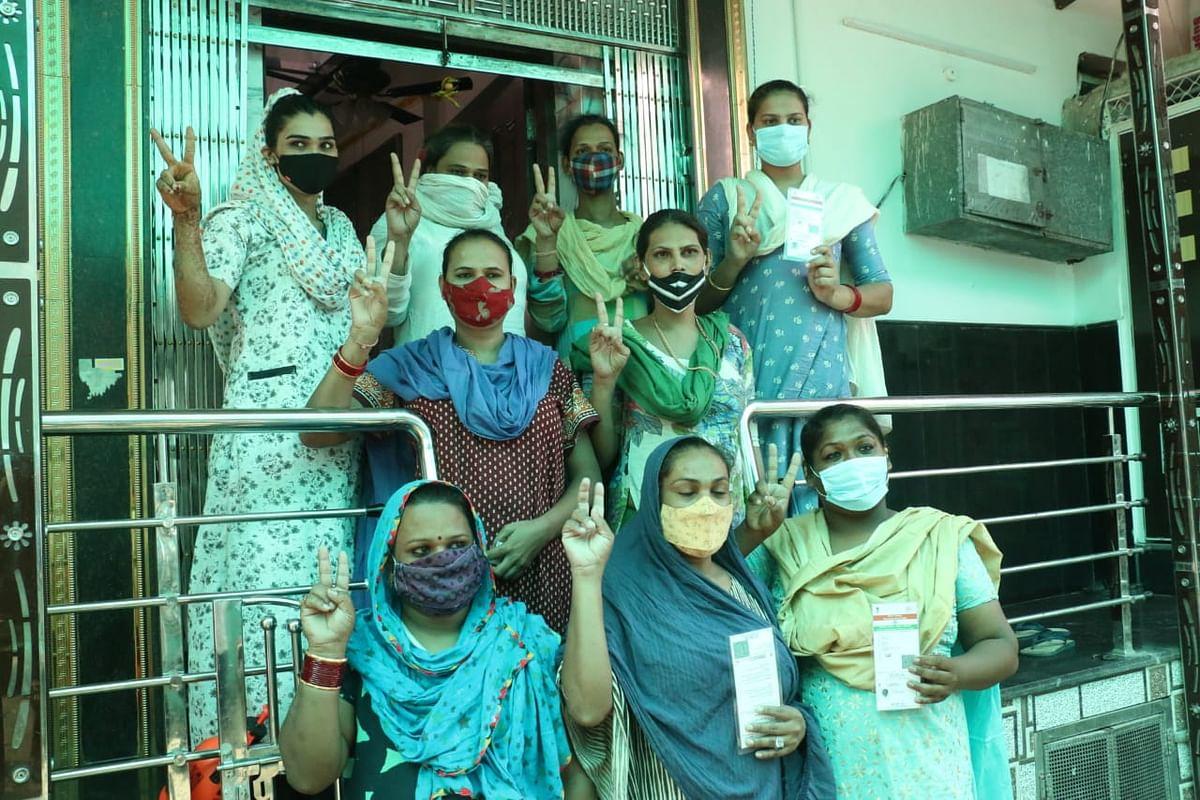 Transgenders show V sign after vaccination in Nandlalpura in Indore on June 4, 2021