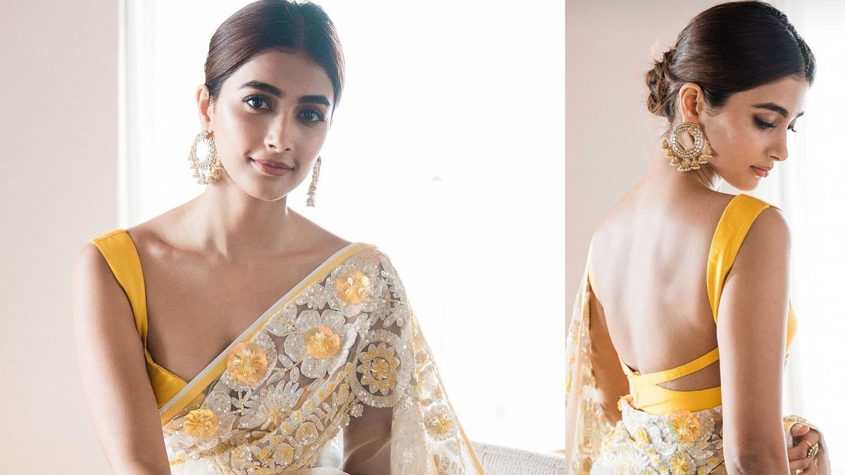 Pooja Hegde flaunts her svelte figure in a sexy saree with backless blouse