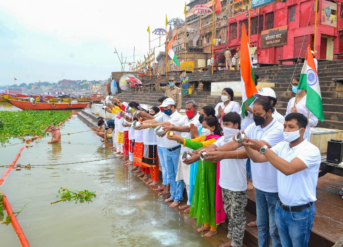 Namami Gange activists offer prayers at Ganga Ghat on the occasion of the Ganga Dussehra festival in the ongoing Covid-induced lockdown, in Varanasi, Sunday, June 20, 2021.