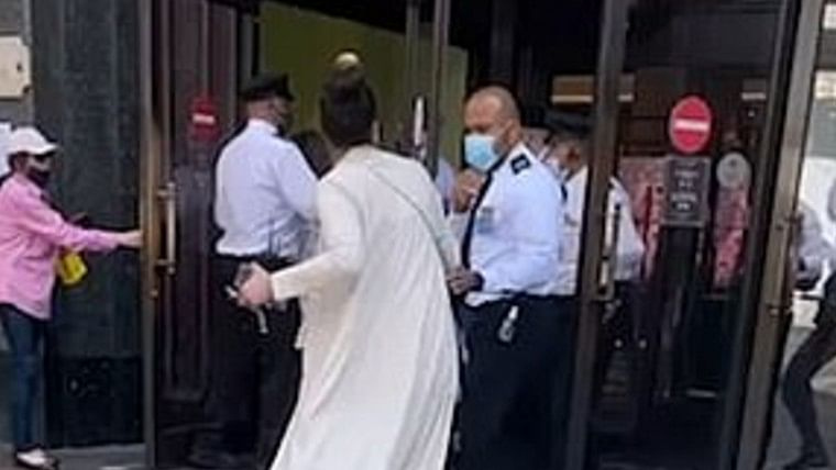 Watch: Woman spits on guard after being forced out of Harrods store for 'refusing to wear mask' in London, arrested