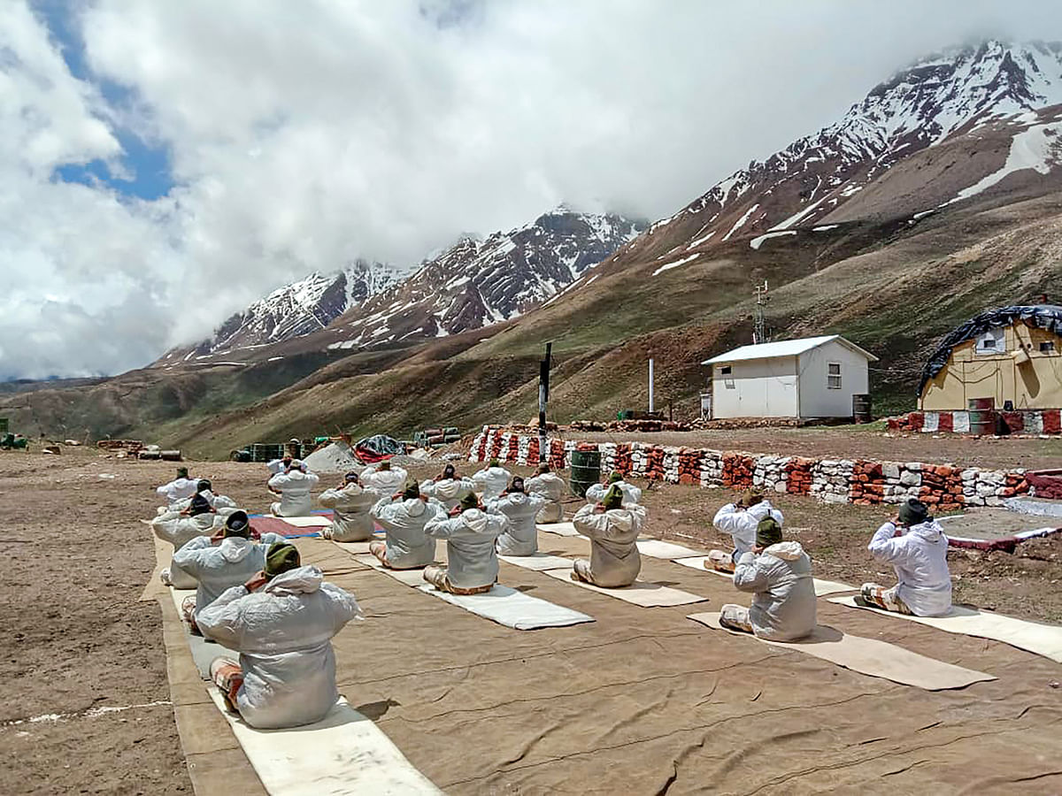 ITBP (Indo-Tibetan Border Police) personnel perform Yoga on the occasion of International Day of Yoga, at a border out post (BoP), in Joshimath, Monday, June 21, 2021.