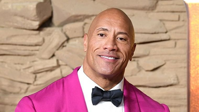 Dwayne Johnson collaborating with Amazon Studios for a holiday action comedy titled 'Red One'