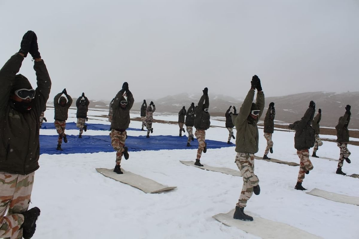 ITBP (Indo-Tibetan Border Police) personnel perform Yoga at an altitude of 18,000 ft in Ladakh, on International Day Of Yoga.