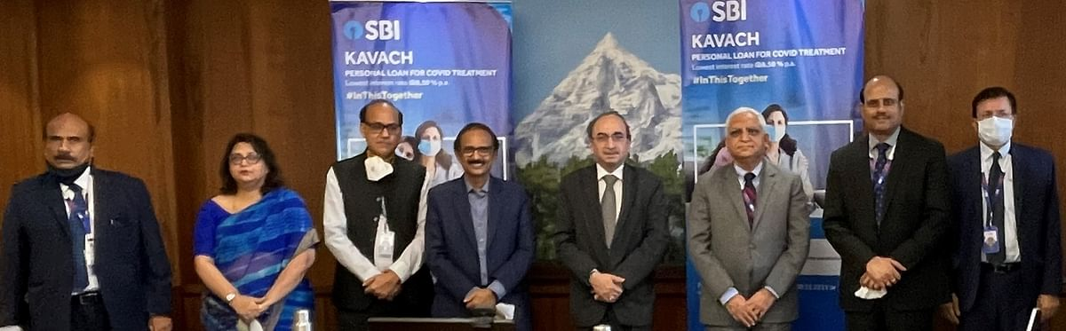 Dinesh Khara, Chairman, SBI, with managing directors, other officials at the launch of SBI Kavach Personal Loan scheme