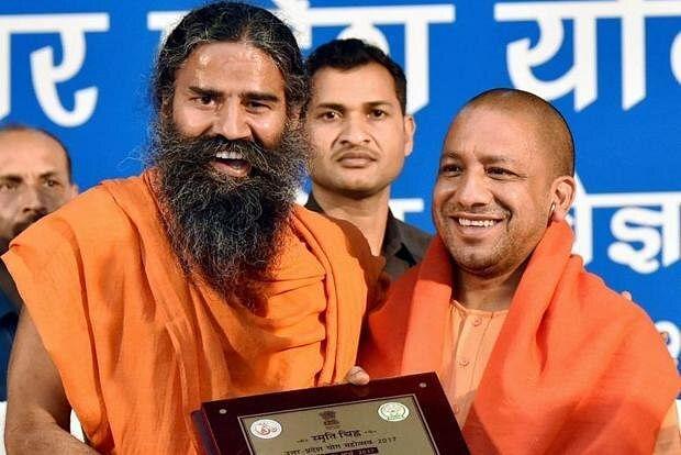 UP CM  Yogi Adityanath alongside Baba Ramdev