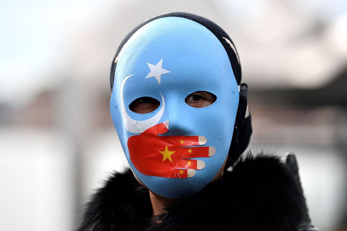 A protester wearing a face mask attends a demonstration in Sydney on June 23, 2021 to call on the Australian government to boycott the 2022 Beijing Winter Olympics over China's human rights record.