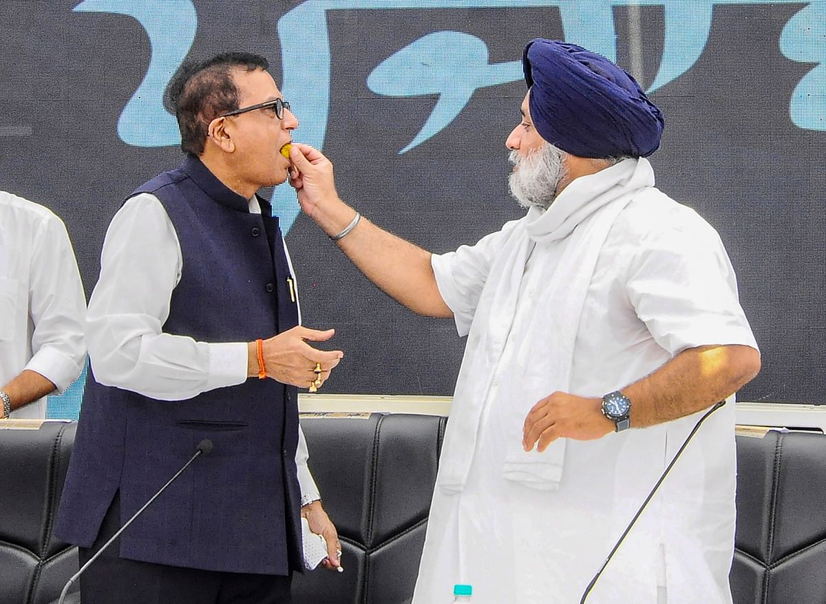 Chandigarh: Shiromani Akali Dal (SAD) President Sukhbir Singh Badal offers sweets to Bahujan?Samaj Party (BSP) Secretary General Satish Chandra Mishra during a joint press conference at the SAD head office in Chandigarh, Saturday, June 12, 2021. The Shiromani Akali Dal (SAD) and the Bahujan Samaj Party (BSP) formed an alliance on Saturday for the 2022 Punjab Assembly election.