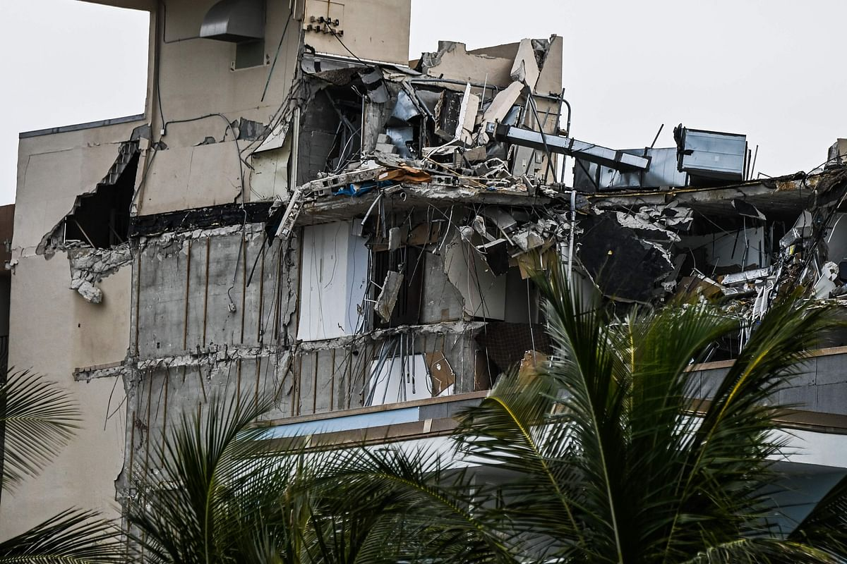 Rubble hangs from a partially collapsed building in Surfside, Florida, north of Miami Beach, on June 26, 2021