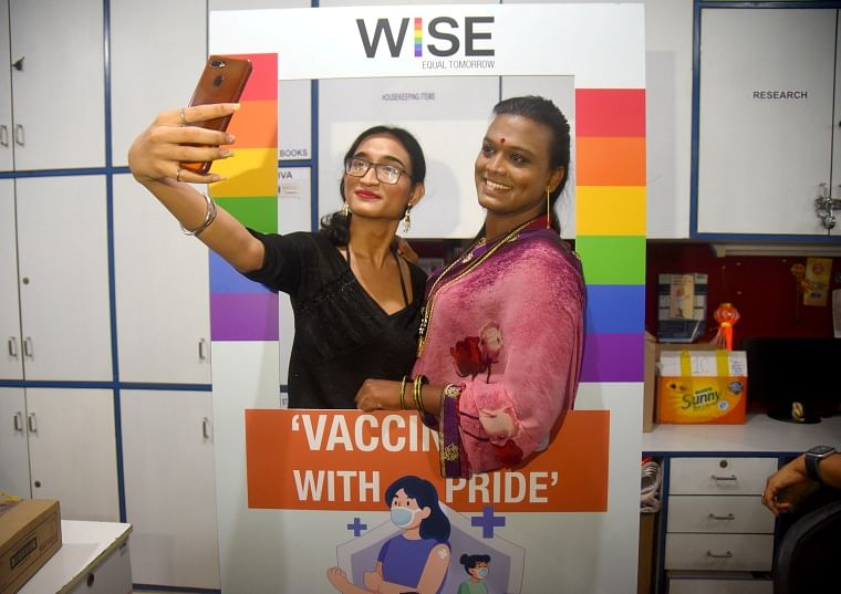 Members from the LGBT community take a selfie after getting a jab