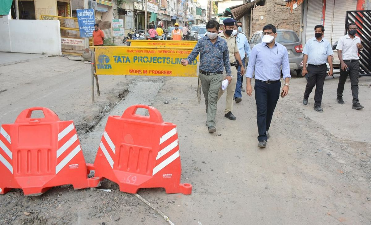 Municipal commissioner Kshitij Singhal on way to inspect sewer pipeline laying work in Ujjain on Tuesday.