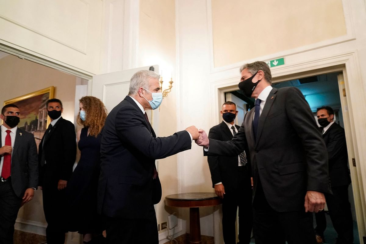 Secretary of State Antony Blinken (R) greets Israeli Foreign Minister Yair Lapid ahead of their meeting in Rome, on June 27, 2021.