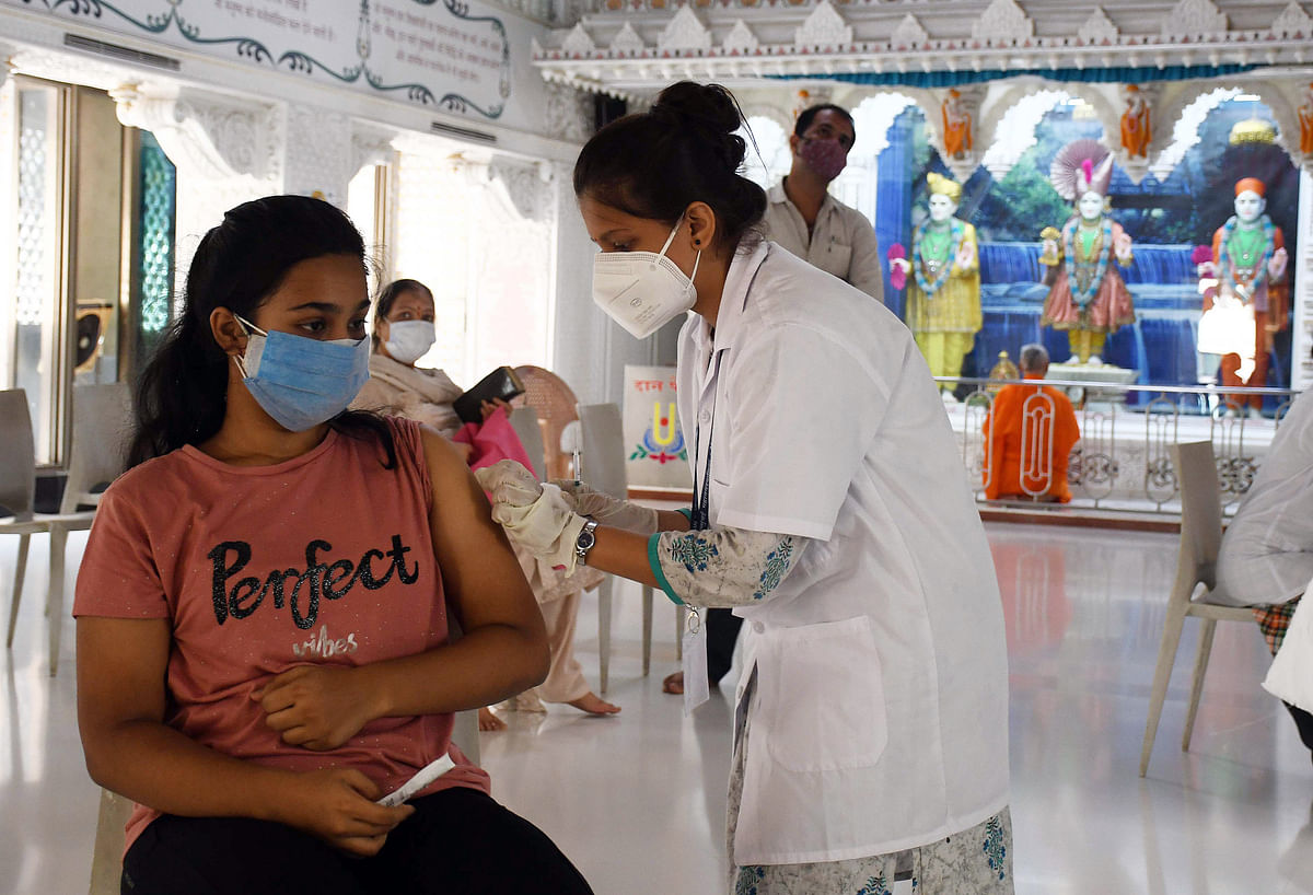 Maharashtra, June 01 (ANI): A beneficiary gets a dose of COVID vaccine during the third phase of the Covid-19 vaccination drive, at Swaminarayan temple, in Mumbai.