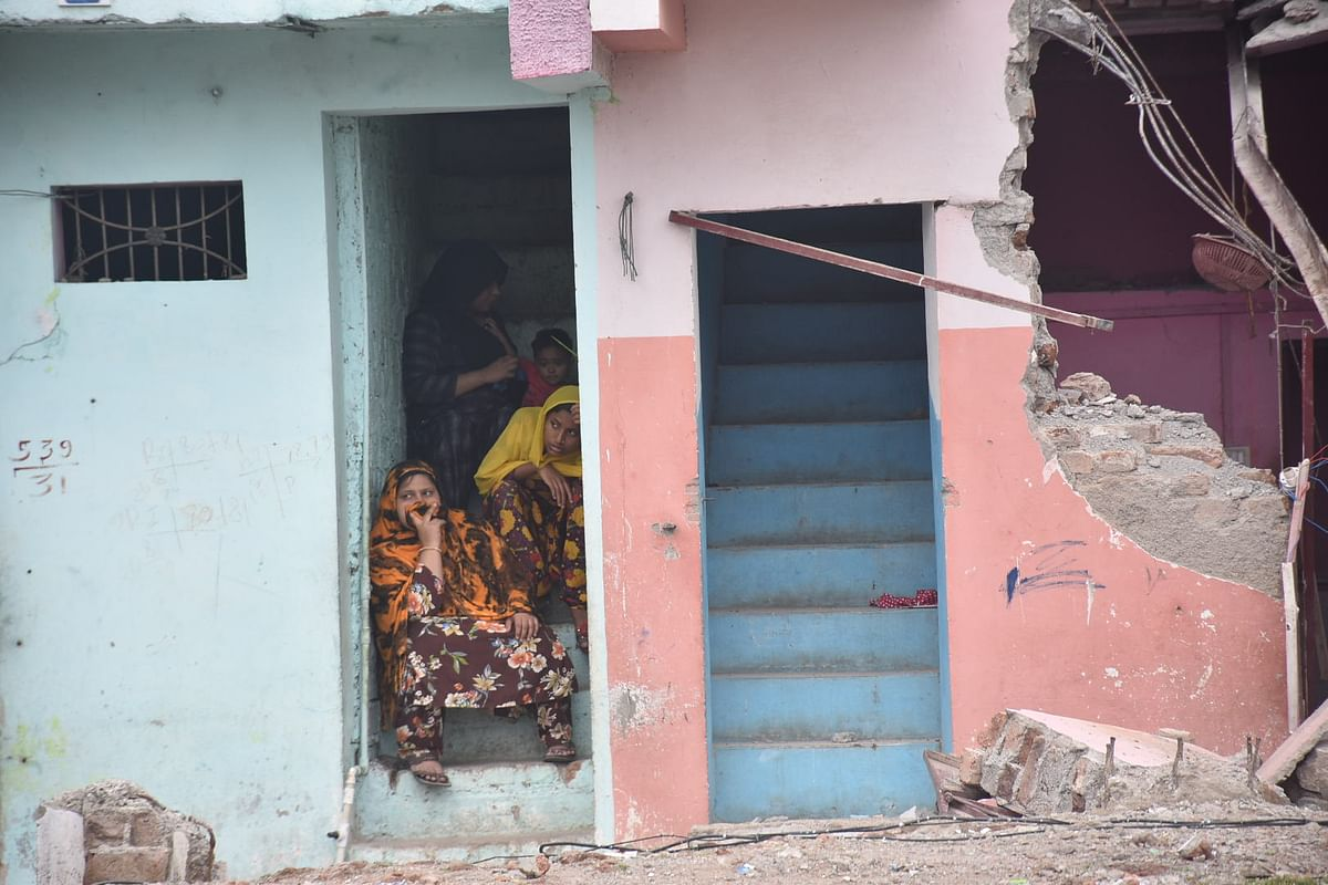 Soon to be oustees (home dwellers) witness the demolition of homes in the Mahakal Tekri and Begam Bagh areas for the execution of Mahakaleshwar Temple Expansion Plan